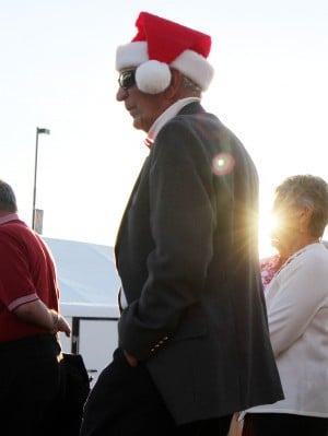 Oro Valley Holiday Tree Lighting: Frank Maisch with the Sun City Singers waits for when him and the rest of the singers take the stage in Oro Valley Friday.  - Randy Metcalf/The Explorer