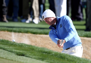Accenture Match Play Championship: Matt Kuchar chips out of the bunker on the 14th during the final round against Hunter Mahan.  - Randy Metcalf/The Explorer