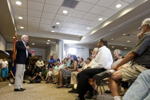 Sen. John McCain: A packed conference room at the Herbert K. Abrams Public Health Center was the setting for Sen. John McCain's Tucson town hall meeting last week. - Randy Metcalf/The Explorer