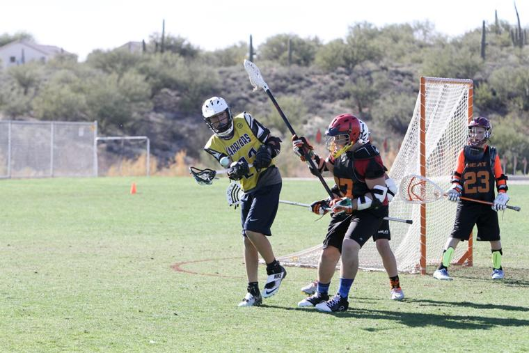 Oro Valley Lacrosse Club 14U - trying to pass.jpg