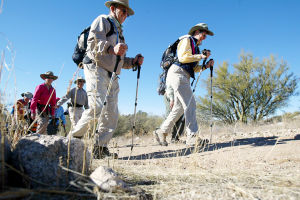 10,000-Mile Hikers: Bob and Leslie Esparza hike with the Sun City Oro Valley's hiking club last week. The couple has logged more than 10,000 miles with the club.  - Randy Metcalf/The Explorer