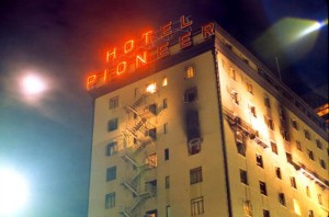 "Firefighter's Film Remembers City Tragedy  : photo by Fred Bear Sr., Half of the sign on the Hotel Pioneer shut down the night of Dec. 19, 1970 when 28 people died in a fire that raged through the downtown building. A documentary film commemorating the event is titled ""Hot Pion,"" named for the neon sign atop the hotel."