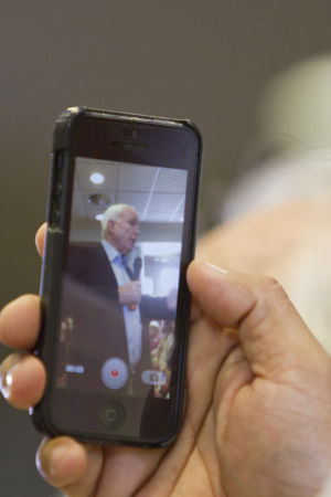 Sen. John McCain: An audience member uses his cellphone to record a video of Sen. John McCain. - Randy Metcalf/The Explorer