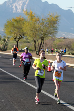 Arizona Distance Classic: Haley Snyder, left and Quincey Smith make their way up Rancho Vistoso Blvd. while racing in the 5K.  - Randy Metcalf/The Explorer