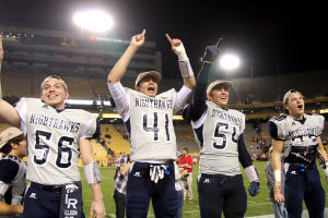 Ironwood Ridge Wins Division II State Football: John Nelson, left, Tyler Berson, Joe Vetrano and other players celebrate with the fans after the game. - Jon Grimes/Special to the Explor