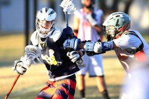 Oro Valley Lacrosse Club: Cole Frost, right, pushes Josh Kelly as he drives for the goal.  - Randy Metcalf/The Explorer