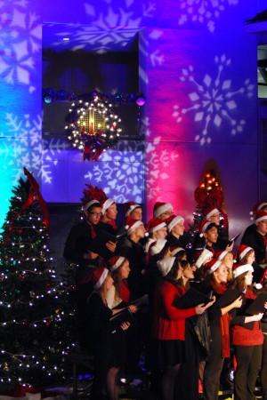 Marana Holiday Tree Lighting: The Marana High School Singers perform for the crowd gather in Marana Saturday.  - Randy Metcalf/The Explorer