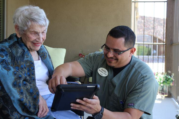 Sonora CNA works with resident on iPad
