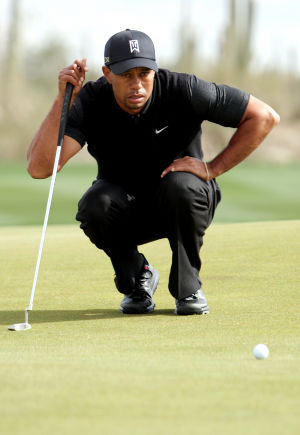 Accenture Match Play Championship: After play resumed Thursday, Tiger Woods lines up his putt on the fourth hole during his match against Charles Howell III. Howell defeated Woods.  - Randy Metcalf/The Explorer