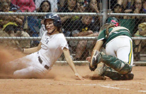 Ironwood Ridge Vs Canyon Del Oro Softball: Ironwood Ridge's Robyn Porter safely slides into home before Canyon Del Oro's Samantha Nettling gets the tag at Cherry Field in a quarter finals Division ll game last week. Ironwood Ridge won 4-0 and went on to play for the state championship Monday.  - Randy Metcalf/The Explorer