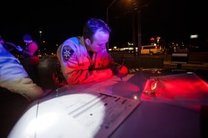 HIOP: Pima County Sheriff Deputy Jamie McNeely fills out paperwork during a traffic stop conducted by the High Impact Offender Program.  - J.D. Fitzgerald/The Explorer