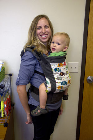 Green Baby Elephant: Holding Marshall Scott, her one-year-old-son, Tonya Scott shows off a baby carrier that is sold on her online baby products website. - Hannah McLeod/The Explorer