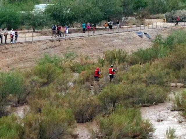 Crews making entry to children in wash