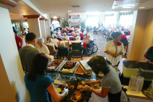 Second Annual First Responders Appreciation Block Party: Residents fill the dinning area of Mountain View Retirement Village for lunch during the second annual First Responders Appreciation Block Party. - Randy Metcalf/The Explorer