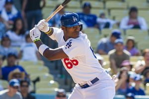 Yasial Puig: Yasial Puig - Courtesy of Sports Illustrated