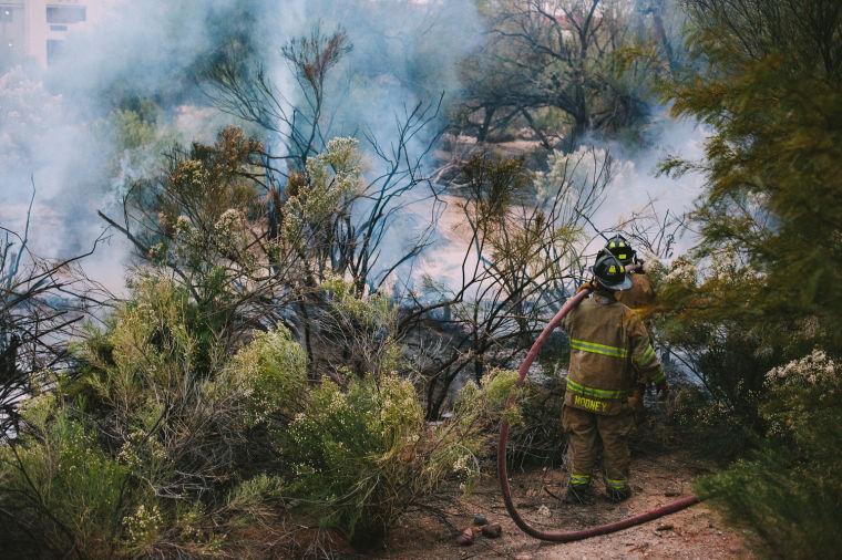 Northwest Fire extinguishes brush fire near apartment complex