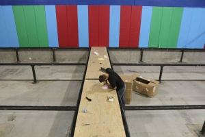 AZ Air Time: Liam Sorensen, an AZ Air Time welder and fitter, installs a platform between where six trampolines will go for a dodge ball section within the Air Time facility in Northwest Tucson. AZ Air Time is set to open this Saturday, which is located at 3931 W. Costco Drive. - Randy Metcalf/The Explorer