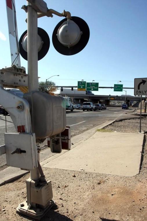 An elevated Ina may cross railroad, I-10