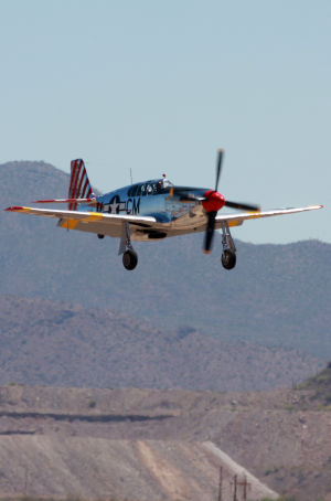 Wings Of Freedom Tour: The P51 Mustang comes in for a landing.  - Randy Metcalf/The Explorer