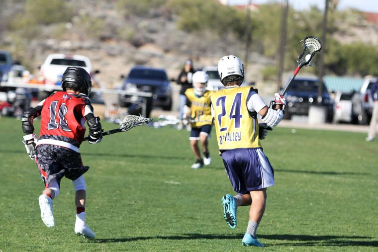 Oro Valley Lacrosse Club 12U - about to pass.jpg