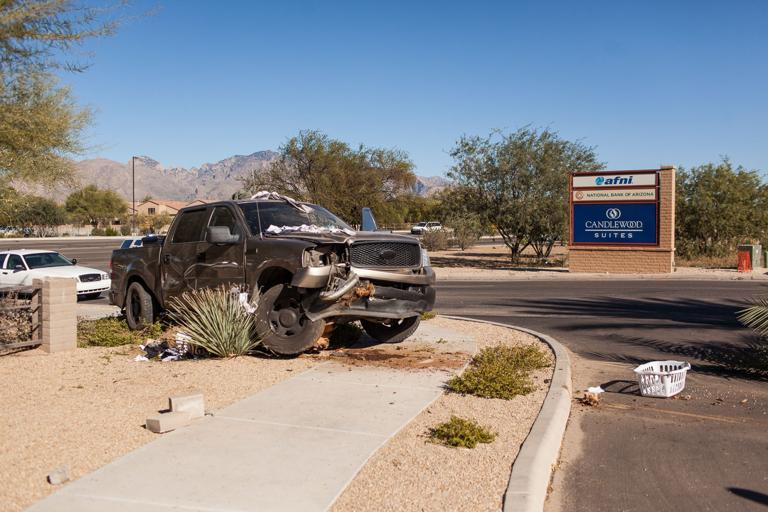 Two teens carjack man with fake gun, wreck following pursuit