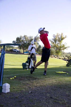 CDO Golf (copy): Chris Meyers practices at the Oro Valley Country Club with the Canyon Del Oro golf team.  - Hannah McLeod/The Explorer