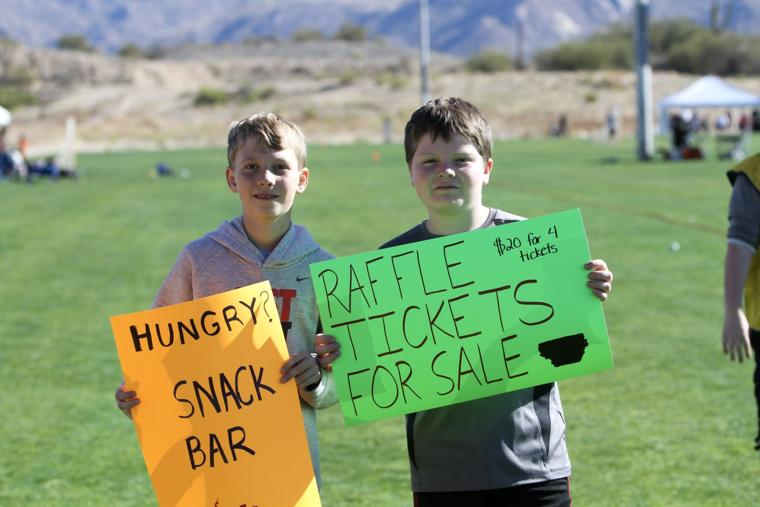Oro Valley Lacrosse Club snack bar and raffle signs.jpg