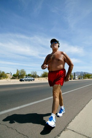Don Kimball 1: Don Kimball, who is retired from the Air Force, jogs along Ina Road and streets in the Northwest exercising, relieving stress and trying to make people smile.   - Randy Metcalf/The Explorer