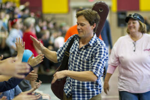 Country Music Artist Bryan White: As he left the gym, Bryan White gave high-fives to the students seated in the bleachers. - Randy Metcalf/The Explorer