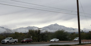 Snow Day: As the clouds started to clear in the west, the snow can be seen on the Tucson Mountains.  - Brandon Hays/The Explorer