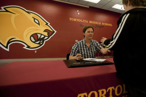 Country Music Artist Bryan White: After his performance and talk, Bryan White signed autographs for the students. - Randy Metcalf/The Explorer