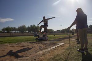 MHS Track: Derrick Velasquez jumps into the sand pit in the long jump.  - Hannah McLeod/The Explorer