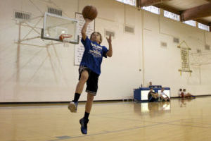 PRCA Basketball Camp: Cameron Drescher, a sixth-grader at BASIS Oro Valley School, goes in for the layup at the Pusch Ridge basketball camp.  - Hannah McLeod/The Explorer