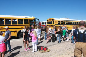 Bus Accident: Students are taken off the two school buses one by one, which were involved in an accident outside of Wilson K-8 School Tuesday afternoon.  - Randy Metcalf/The Explorer