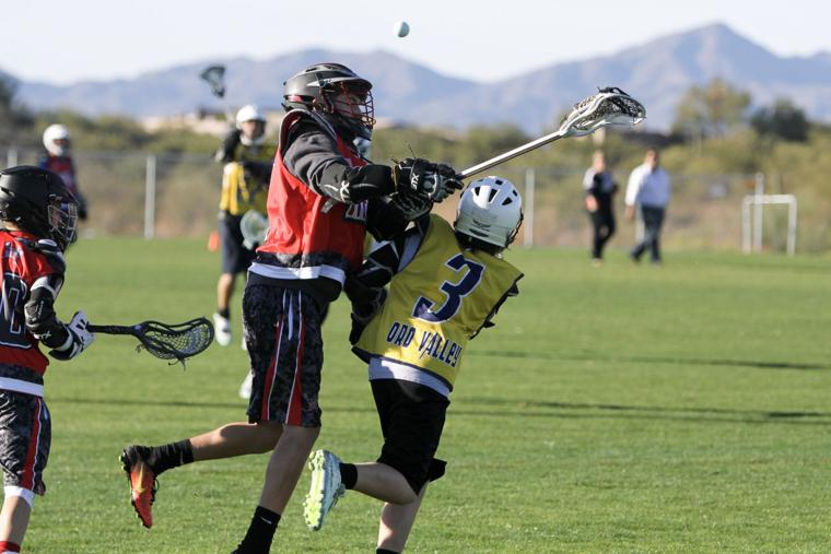 Oro Valley Lacrosse Club 12U - just makes the pass.jpg