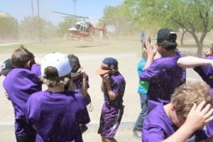 Drug Awareness Day: Painted Sky Elementary School students shield their faces from flying debris as a Arizona LifeLineÕs helicopter takes off from the annual Drug Awareness Day in Oro Valley last Friday.  - Randy Metcalf/The Explorer