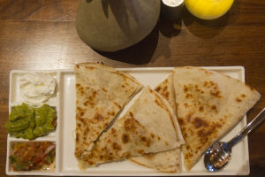 Sippin Socail - Cayton's Burger Bistro: The Sonoran Quesadilla is served with guacamole, sour cream, and pico de gallo. - Randy Metcalf/The Explorer