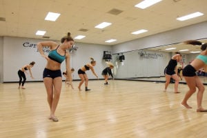 Ironwood Ridge High School Dance Team: Nighthawk senior Madison Halliday, front left, and the other girls on the Ironwood Ridge High School Dance Team, run through a practice routine last week. - Randy Metcalf/The Explorer
