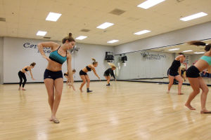 Ironwood Ridge High School Dance Team: Nighthawk senior Madison Halliday, front left, and the other girls on the Ironwood Ridge High School Dance Team, run through a practice routine last week. - Randy Metcalf/The Explorer