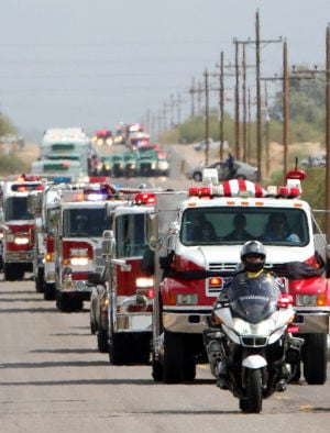 William Warneke Procession: The remains of Granite Mountain Hotshot William Warneke are carried atop a Prescott Fire Department fire truck during the procession of emergency vehicles that spanned more than two and a half miles. - Randy Metcalf/The Explorer