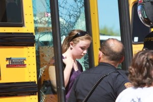 Bus Accident: Kat Oetting, a seventh-grader at Wilson K-8 School, is released to her family after getting off the bus, which rear-ended another bus just outside of the school.  - Randy Metcalf/The Explorer
