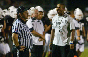 "Clarence ""Bam"" McRae: Mountain View High School's head coach Clarence ""Bam"" McRae tries to explain to a sideline referee about a penalty he kept seeing happen. - Randy Metcalf/The Explorer"