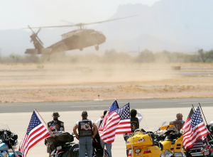 William Warneke Funeral: Motorcyclists look on as a Black Hawk helicopter lands at the Marana Regional Airport carrying William Warneke, one of the 19 firefighters lost from the Granite Mountain Hotshots. - Hannah McLeod/The Explorer