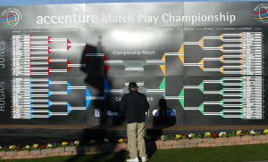 Accenture Match Play Championship Warm Ups: Northwest resident Bill Burns looks over the Accenture Match Play Championship bracket Tuesday morning.  - Randy Metcalf/The Explorer Newsp