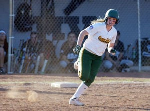 Canyon Del Oro Vs Mountain View Softball: Canyon Del Oro's Brittany Young rounds first base on a shot to right field for a triple.  - Randy Metcalf/The Explorer