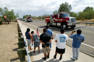 William Warneke Procession: Members of the community line Sanders Road during the procession for Granite Mountain Hotshot William Warneke last week. - Randy Metcalf/The Explorer