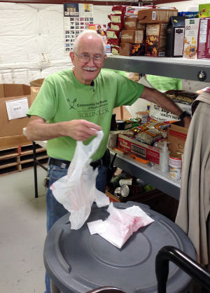 Bob Blaiz: Marana Community Food Bank volunteer Bob Blaiz unloads donated food.  - Courtesy Photo