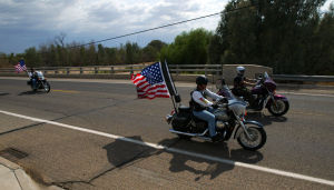 William Warneke Procession: Motorcyclists bring trail behind the procession in Marana for William Warneke who died fighting the Yarnell Hill fire near Prescott. - Randy Metcalf/The Explorer
