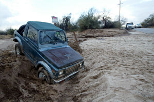 Road Closure: The rain on Friday and Saturday caused plenty of problems in north Tucson, as vehicles were left stranded, and roads were closed at Overton and La Cholla.  - Randy Metcalf