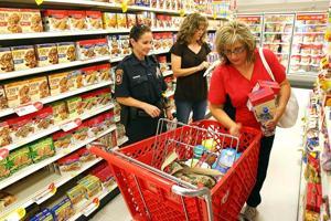 Police shop with teachers